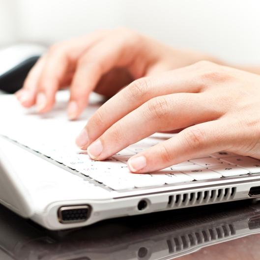 hands-laptop-computer-writing